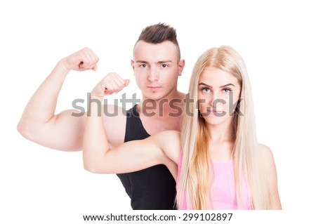 Fitness and aerobic trainers or couple flexing biceps with confidence on white studio background - stock photo
