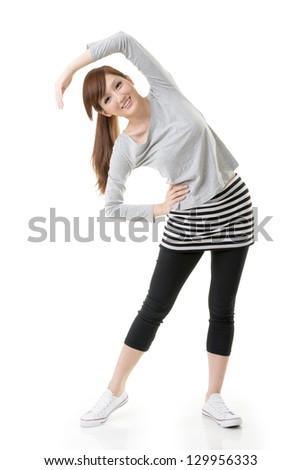 Fitness Asian girl doing stretch exercise, full length portrait isolated on white background. - stock photo