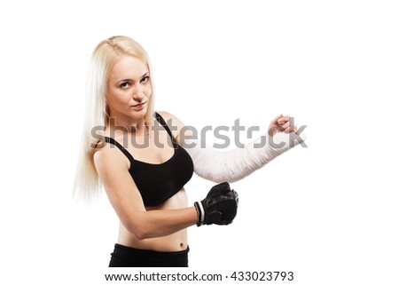 Fitness blond girl with a broken arm in plaster, boxing pose - stock photo