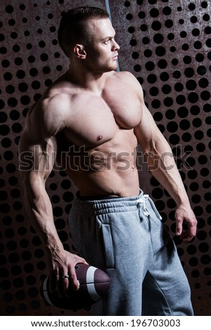 Fitness, bodybuilding. Powerful man with ball - stock photo
