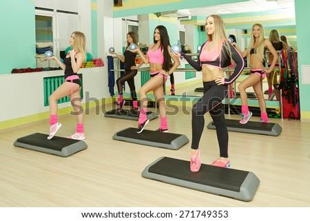 Fitness center. Image of athletic girls training  - stock photo