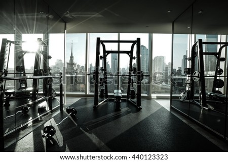 Fitness club in luxury hotel interior in the morning with sunshine. - stock photo