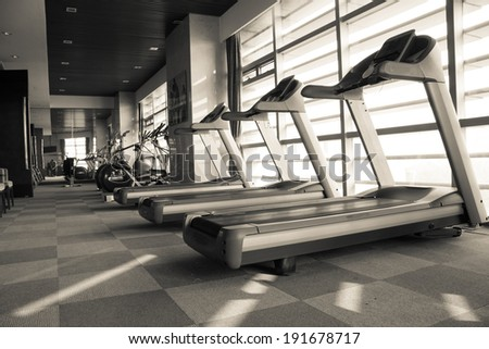 Fitness club weight training equipment gym modern interior - stock photo
