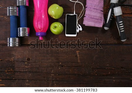 Fitness concept. Various elements over a wooden background - stock photo