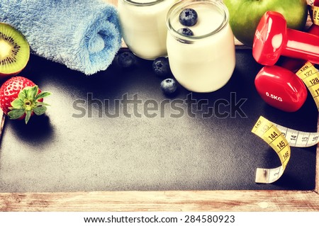 Fitness concept with dumbbells and healthy food. Copy space - stock photo