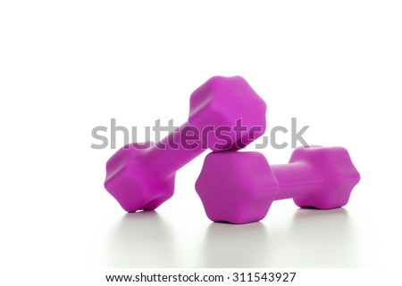 Fitness concept with two pink dumbbells on white background, closeup  - stock photo