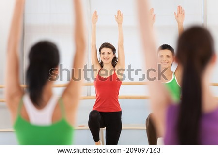 Fitness dance class doing aerobics. Women dancing happy energetic in gym fitness class.  - stock photo