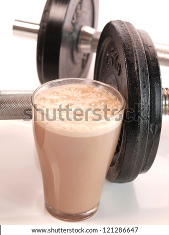 fitness drink with heavy weights stock photo