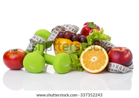 fitness equipment and healthy food isolated on white (green apple, pepper, grapes, nectarines, kiwi, orange, dumbbells and measuring tape)  - stock photo