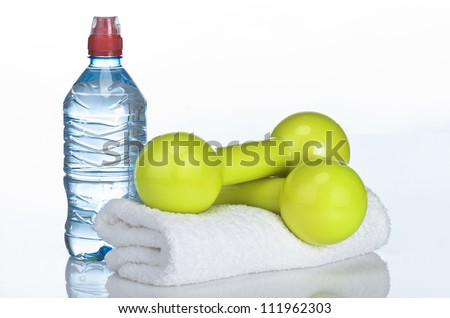 Fitness equipment towel, water, dumbbell - stock photo