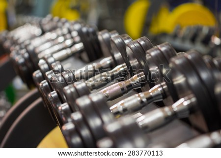 Fitness exercise equipment dumbbell weights - stock photo