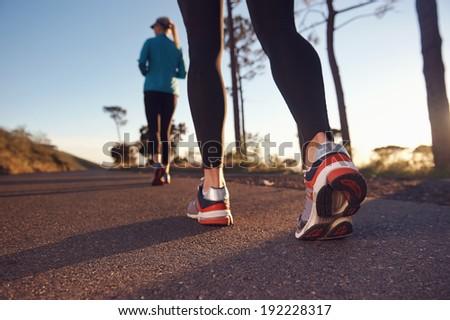 fitness exercising couple training for marathon running lifestyle - stock photo