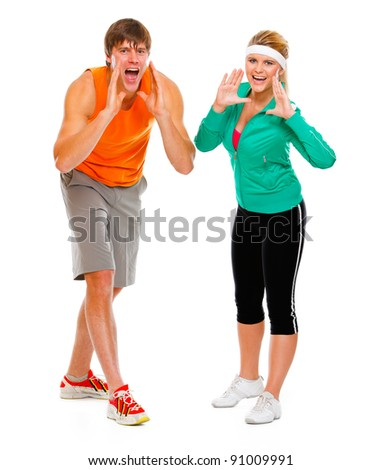 Fitness girl and man in sportswear shouting through megaphone shaped hands isolated on white - stock photo