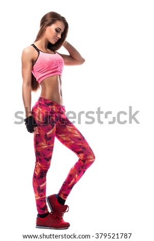 Fitness girl with slim legs on white background - stock photo