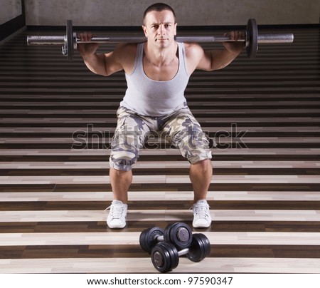 Fitness instructor showing proper weightlifting - stock photo