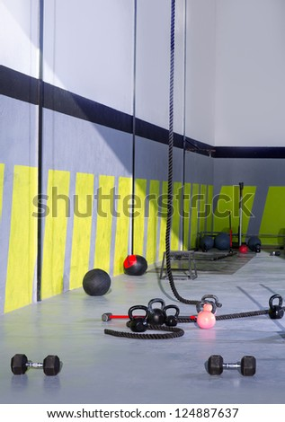 Fitness Kettlebells ropes and hammer gym with lifting bars and wall balls - stock photo