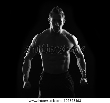 Fitness male on black - stock photo