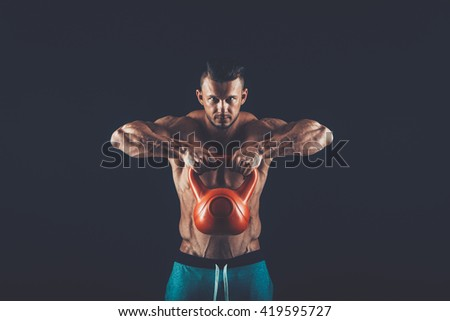Fitness man doing a weight training by lifting  heavy kettlebell - stock photo
