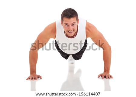 fitness man doing push ups over white background - stock photo