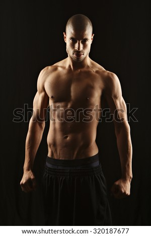 Fitness man, low key lighting - stock photo