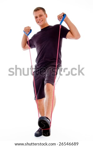 fitness man posing with stretching rope with white background - stock photo