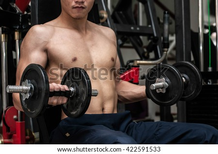 Fitness men in training. fitness showing - stock photo