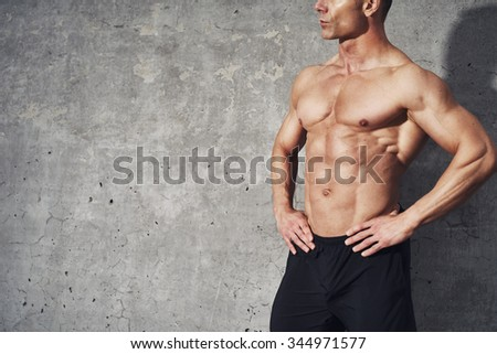 Fitness portrait half body six pack no shirt, fitness concept, room for copyspace, fit and healthy muscular male body with abdominal muscles - stock photo