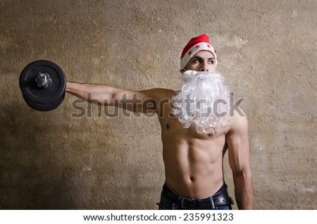 Fitness Santa Claus lifting dumbbells weights - stock photo