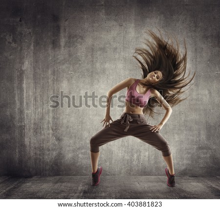 Fitness Sport Dance, Woman Dancer Flying Hair Dancing over Concrete background - stock photo