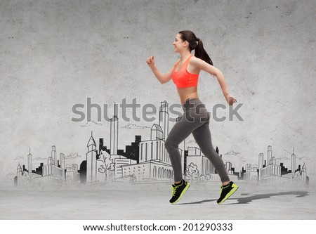 fitness, sport, exercising and dieting concept - beautiful sporty woman running in front of the city drawing - stock photo