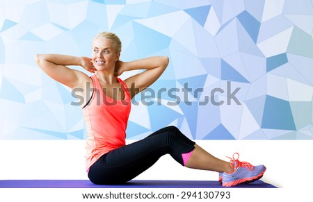 fitness, sport, exercising and people concept - smiling woman doing sit-up on mat over blue low poly background - stock photo