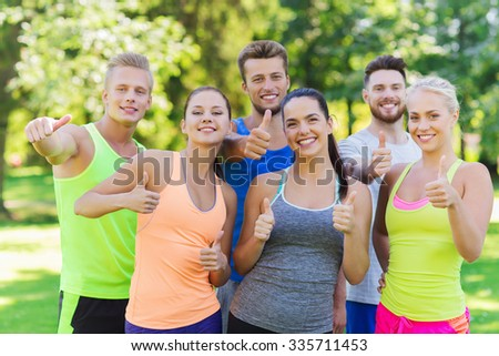 fitness, sport, friendship and healthy lifestyle concept - group of happy teenage friends or sportsmen showing thumbs up outdoors - stock photo