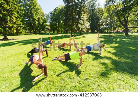 fitness, sport, friendship and healthy lifestyle concept - group of happy teenage friends or sportsmen exercising at boot camp - stock photo