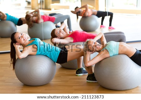 fitness, sport, training and lifestyle concept - group of smiling women with exercise balls in gym - stock photo