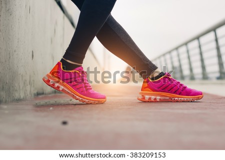 fitness, sport, training, people and lifestyle concept- Women legs with shoes and sun - stock photo