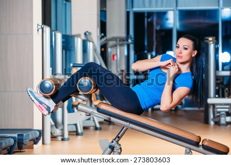 fitness, sports, training, technology and vision for the future lifestyle - smiling woman with the implementation of the simulator exercises in the gym - stock photo