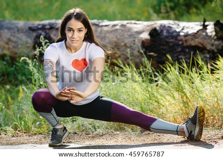Fitness woman doing exercises during outdoor cross training workout. Beautiful young and fit fitness sport model exercising outside. - stock photo