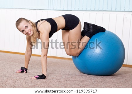 fitness woman doing exercises for muscle press with abs Swiss ball - stock photo