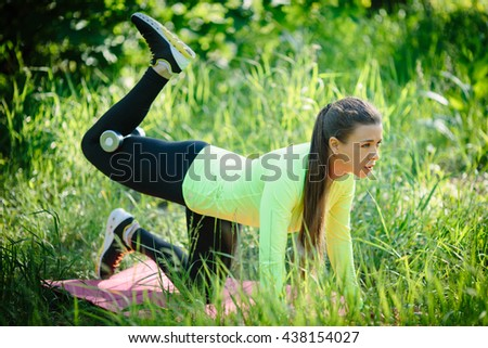 Fitness woman doing push ups Outdoor training workout summer evening side view Concept sport healthy lifestyle - stock photo