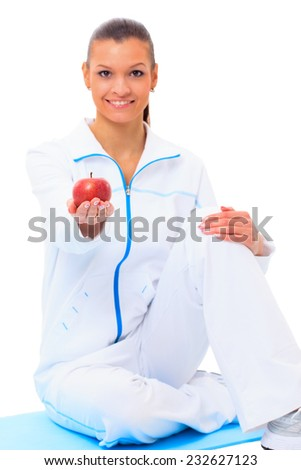 Fitness woman happy smiling holding apple - stock photo