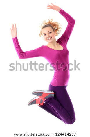Fitness woman jumping excited isolated on white background. - stock photo