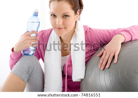 Fitness - woman relax with water bottle exercise ball - stock photo