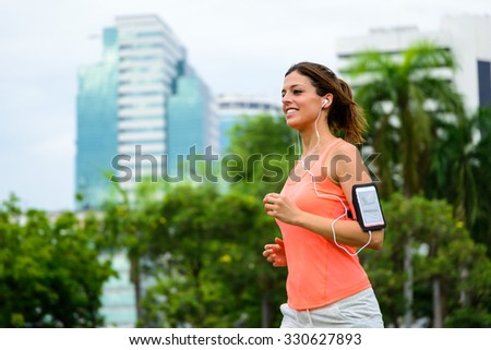 Fitness woman running at city park. Female beautiful athlete exercising outdoor. Lumpini Park, Bangkok. - stock photo