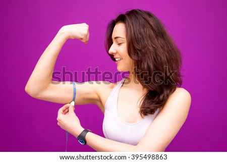 Fitness woman showing fresh energy flexing biceps muscles. - stock photo