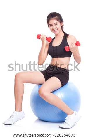 Fitness woman sport training with exercise ball and lifting weights - stock photo