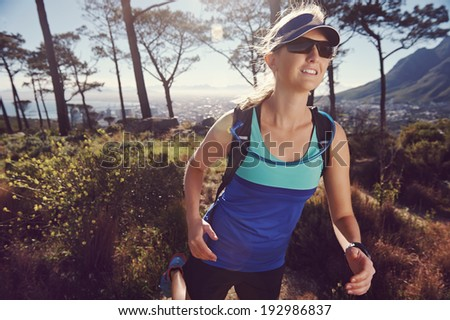 Fitness woman trail running in the mountains at sunrise healthy lifestyle - stock photo