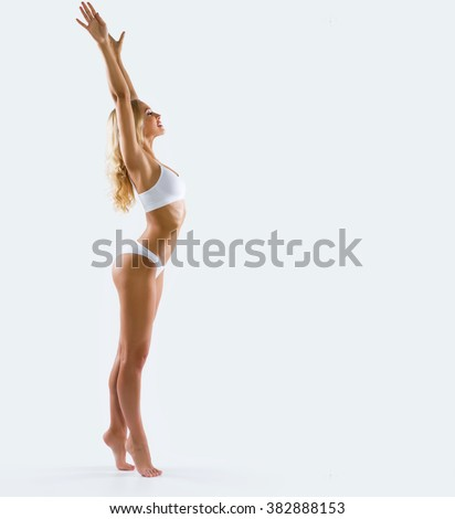Fitness woman with a beautiful body - stock photo