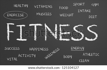 fitness word cloud written on a chalkboard - stock photo