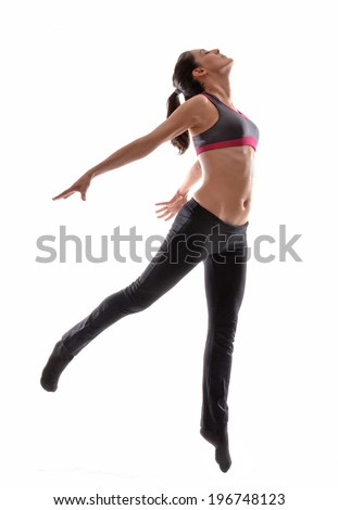 Fitness young woman dancing on white background.Free style beautiful latin woman stretching on white background. - stock photo