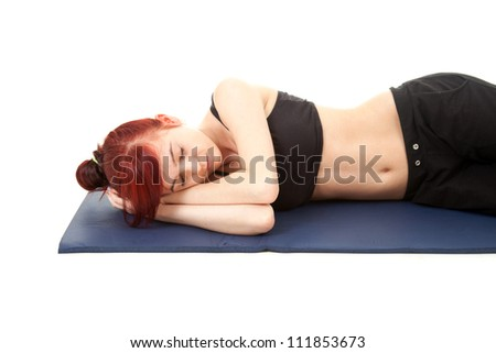 fitness young woman sleeping on the floor, white background - stock photo